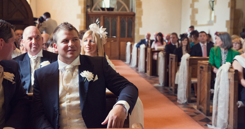 groom-seated-waiting-his-bride-at-the-church-3996