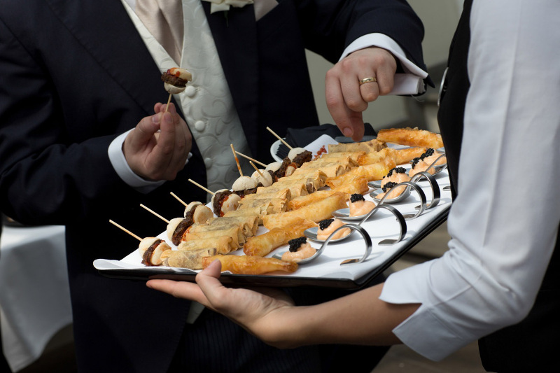 someone-reaching-for-a-canape-4004