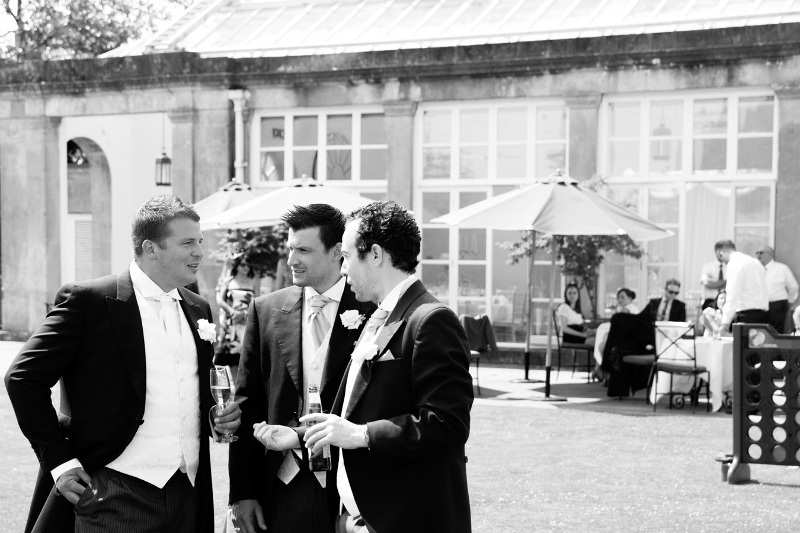 three-people-outside-the-orangery-at-buxted-park-4010