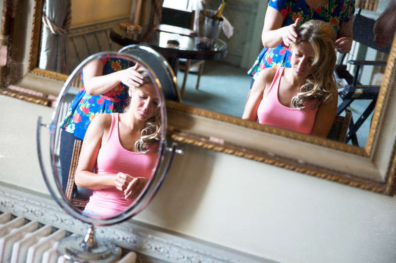 two-reflections-of-the-bride-in-a-mirror-3976